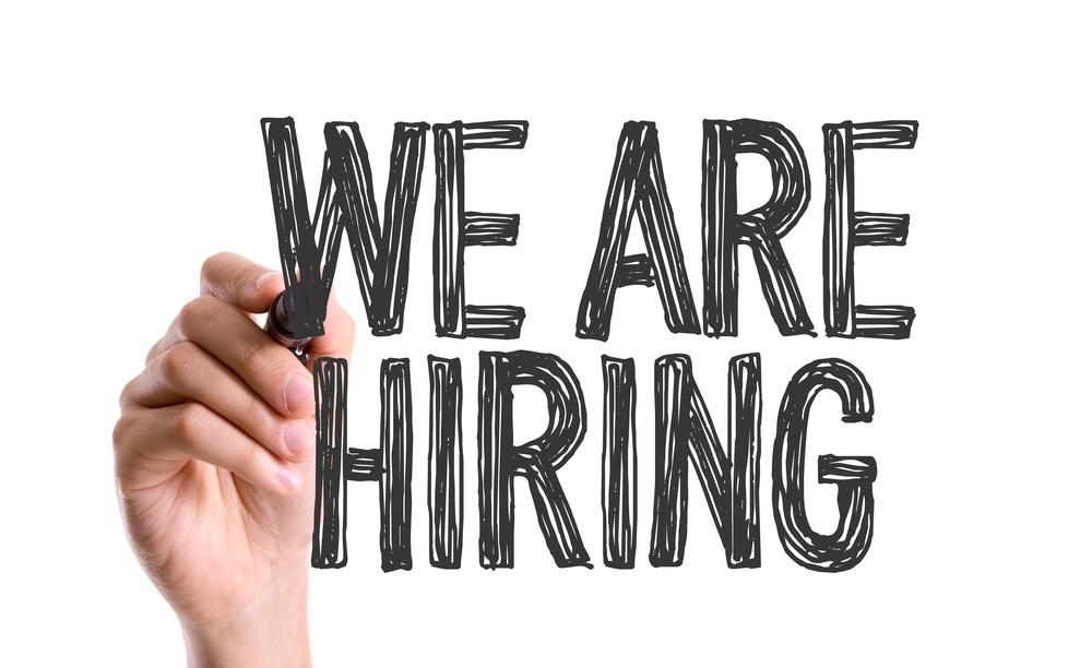 Hand with marker writing We Are Hiring-1