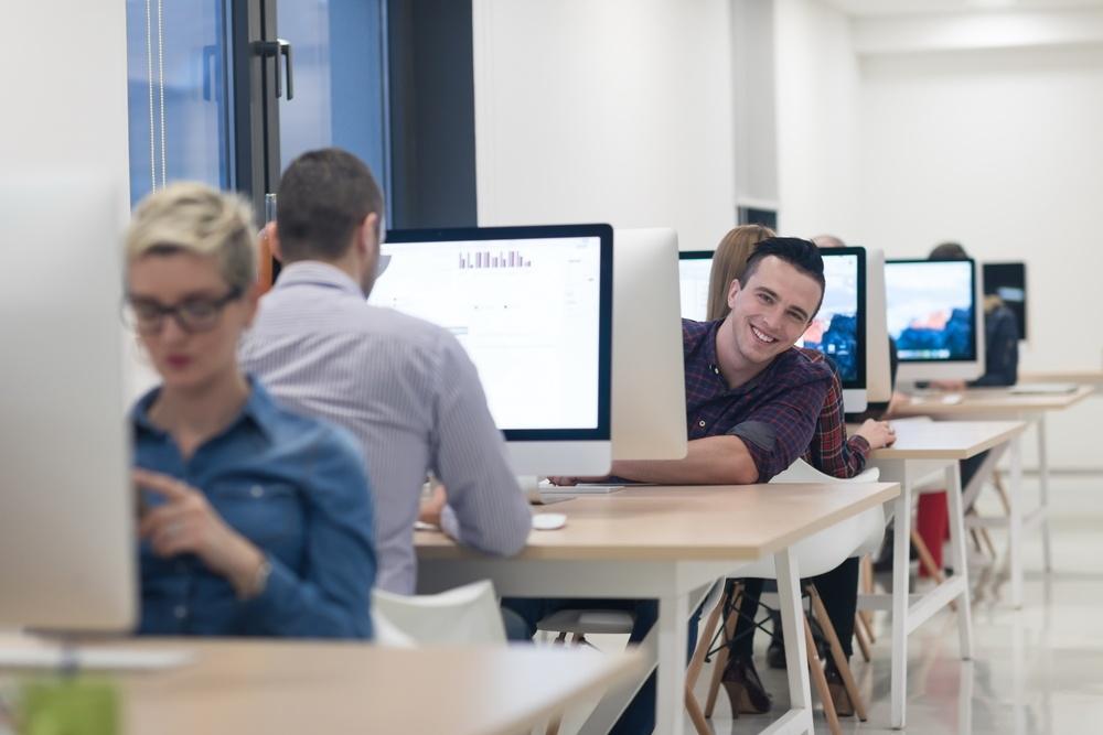 startup business, software developer working on desktop  computer at modern office.jpeg